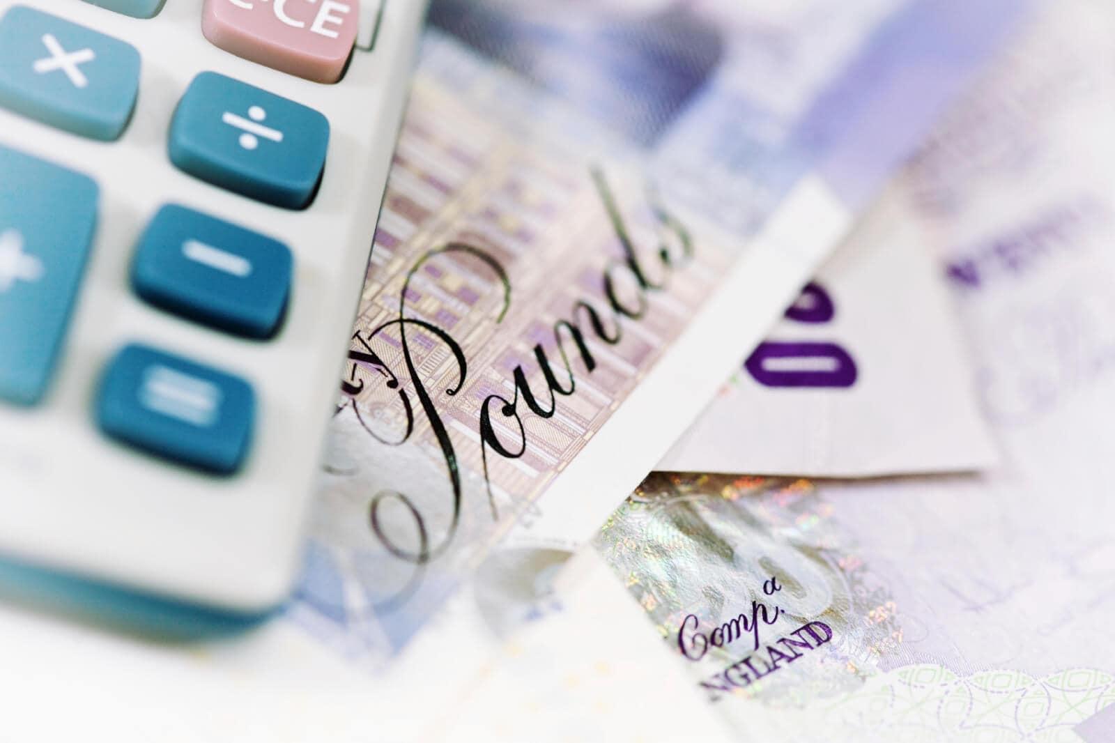 Currency and Calculator - iStock_000004142949_Medium