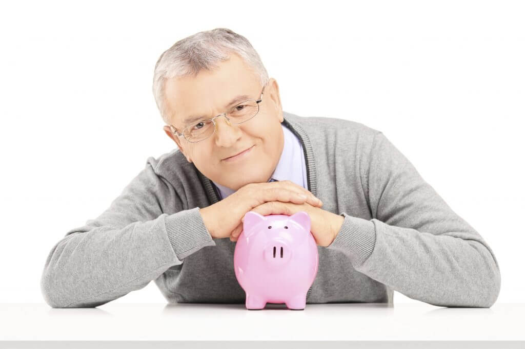 man posing with a piggy bank - iStock_000025588658_Large