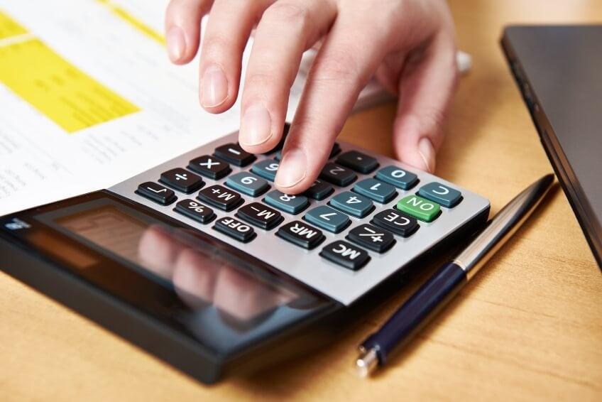 Womens hand using calculator