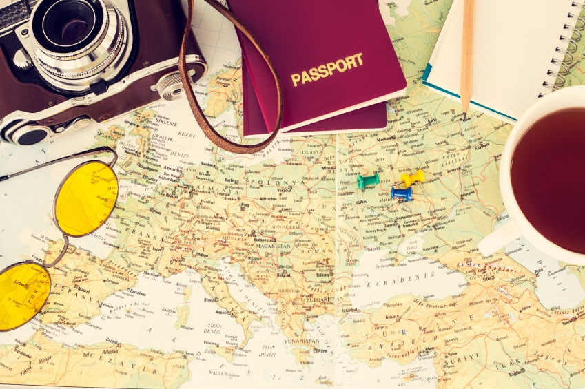passport, map and camera ready for saving money on holiday