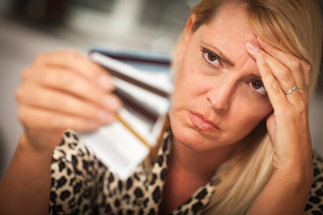 woman looking at her credit cards-iStock_000014536564_XXXLarge