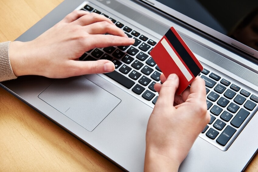 Hand of a woman making purchases through the Internet