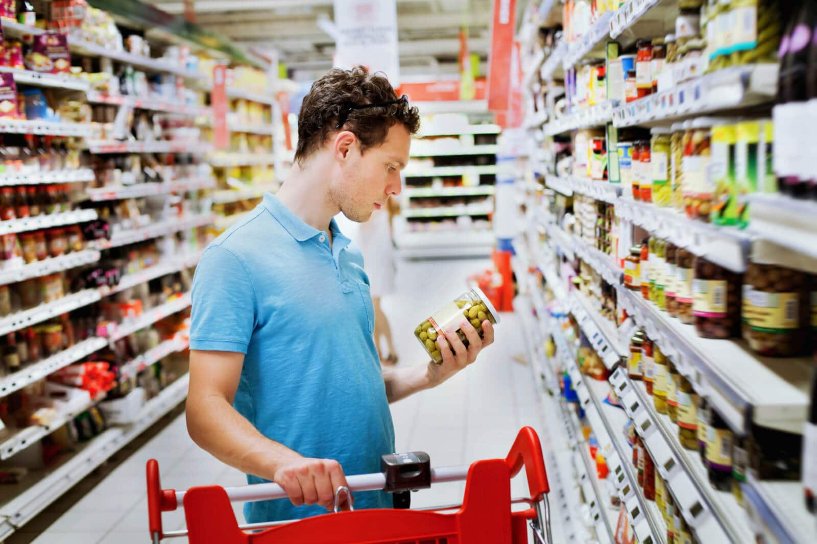 Supermarket, man with olives and trolley