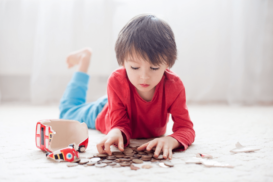 Toddler counting his money